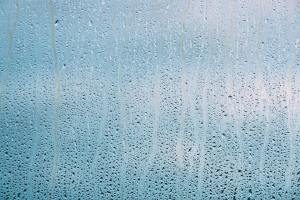 Drops Of Water Or Rain On Wet Glass Background. Moody Photo In C