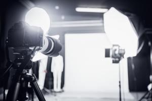 Large photo studio with professional lighting.