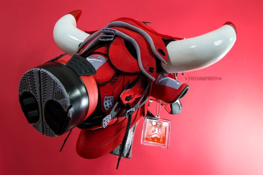 """The """"Toro IV"""" mask is the 70th sneaker mask created by Freehand Profit. Commissioned by K. Santa. Made from 2 pair of Air Jordan 4s """"Toro"""". Find out more about the work on FREEHANDPROFIT.com."""