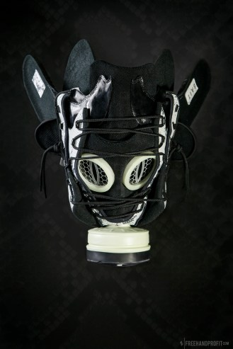 The 75th sneaker mask created by Freehand Profit. Shoes donated by BAIT in Diamond Bar. Made from a single pair of Reebok X BAIT Question Mids. This piece will be auctioned off to benefit Invisible Children Inc. Find out more about the work on FREEHANDPROFIT.com.