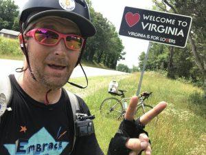 Johnathon Dunker stops for a selfie at the VA border.
