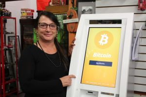Corner News' owner Roberta Mastrogiovanni poses with her store's brand new Bitcoin Vending Machine!