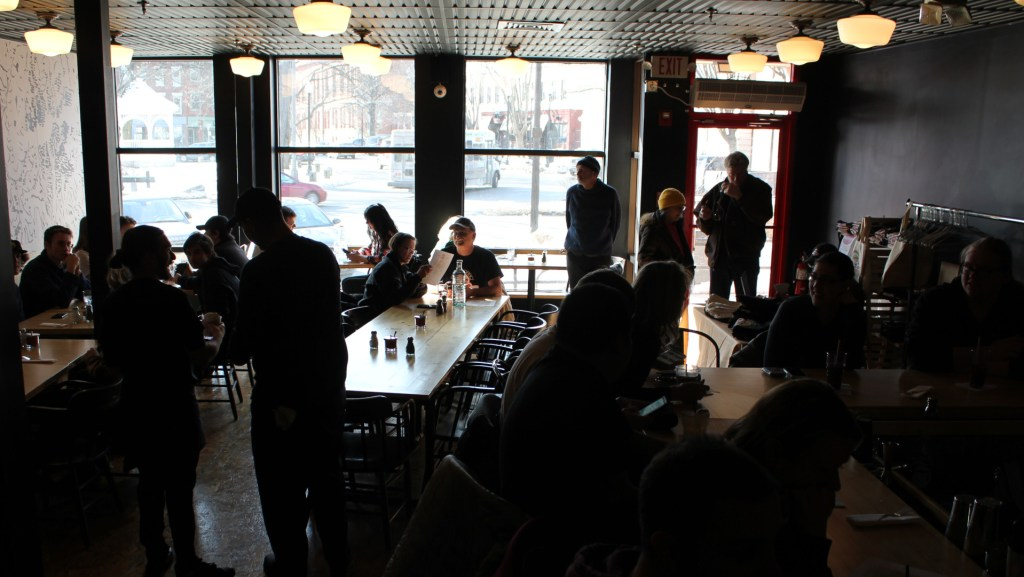 Silhouettes of the intial crowd of customers - view from the bar.