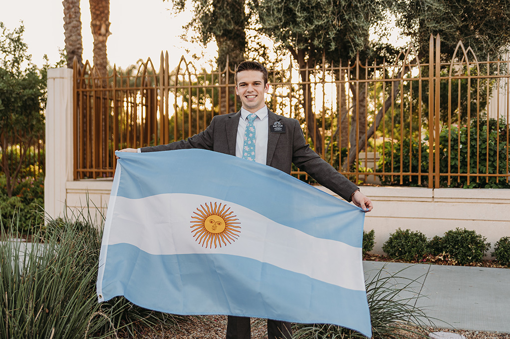 LDS missionary holding argentina flag at gilbert az temple