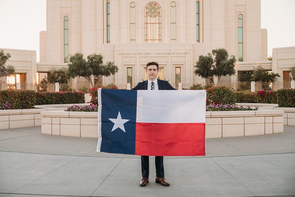 LDS missionary photoshoot in front of the gilbert arizona temple holding Texas flag