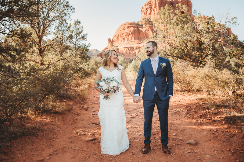 Sedona wedding pictures bride and groom holding hands at Bell Rock