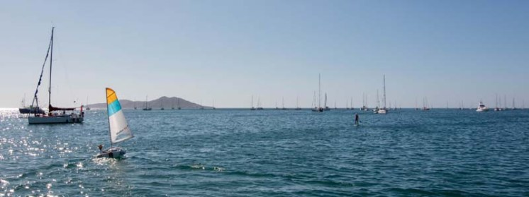Capt. Rand sailing through the Baja Ha-ha fleet in Bahía Tortugas
