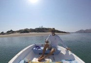 Capt. Rand at the helm of CD as we cross to the beach proper in Pescador