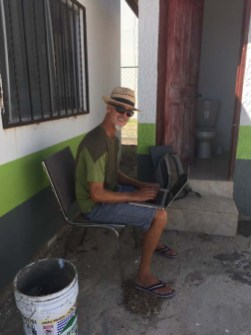 Rand grabbing an internet connection in the Village