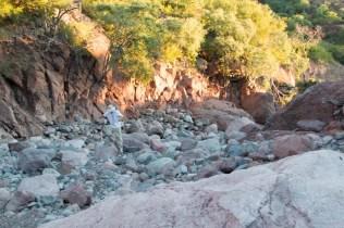 Jason picking his way up the canyon