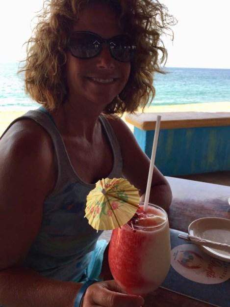 Vicki enjoying her pretty drink at La Huerta