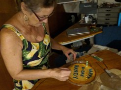 Nancy prepping her homemade coconut flan for the birthday boy