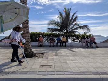 Gary and Rand finding shade during the Mazatlán moto parade