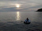 Deb practicing rowing at sunset again
