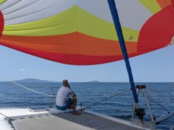 Chatting with the parents while shaded by the pretty sail