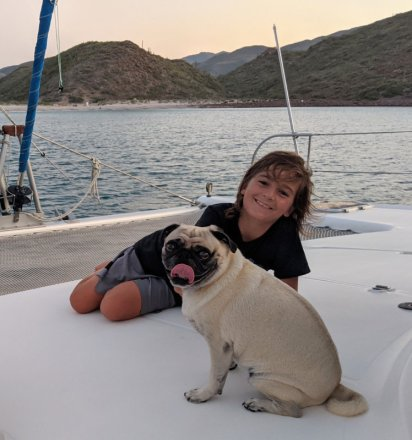 A boy and his pug