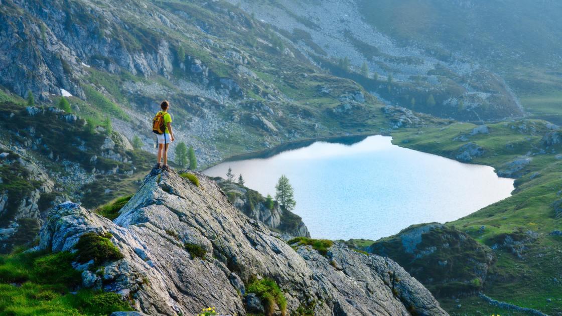 Girl looks mountain lake