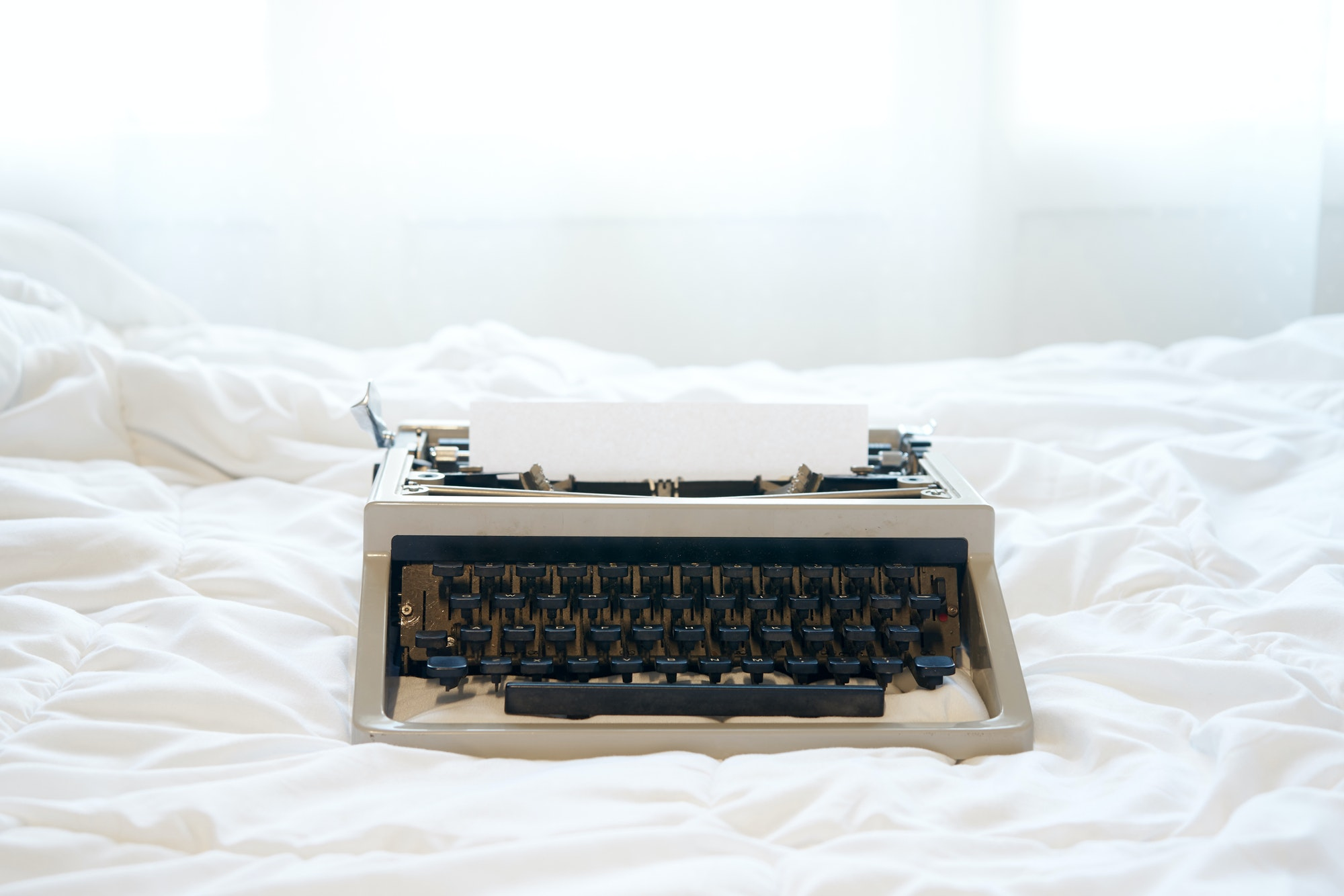 Vintage typewriter on the bed