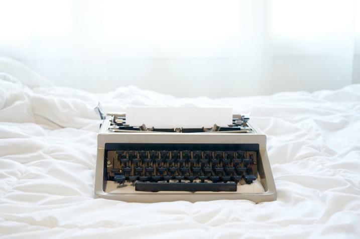 Vintage typewriter on the bed
