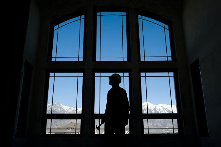 Silhouette of a builder against a window