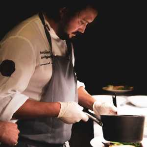 Chef serving food with apron