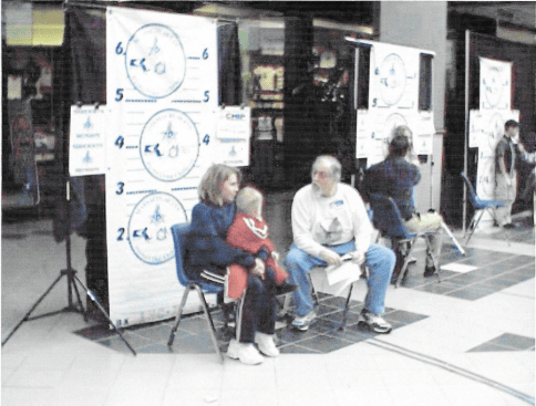 Frederic interviewing mother and child for Paul Revere's Child Identification Program (CHIP)