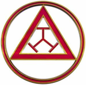 Finding El Dorado Sign of the Order. The triple tau is within a triangle and that is within a circle.