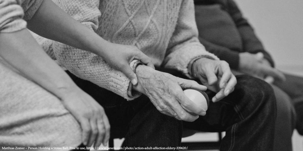 Image of different age people holding hands representing older people in Poland and COVID19