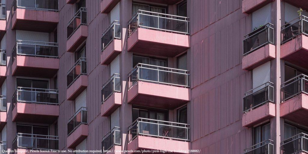 Image of condominiums in Ukraine in a purple coloured building representing condominiums heating