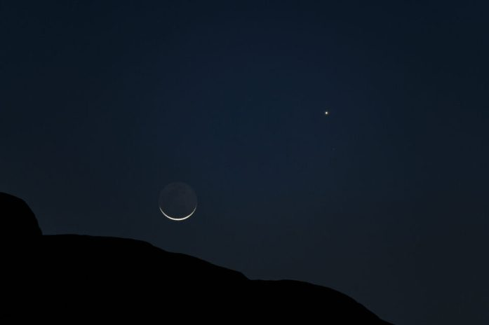 Crescent moon and Venus with some foreground