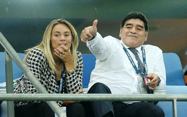 Diego and Oliva watching a football match at a stadium in 2014