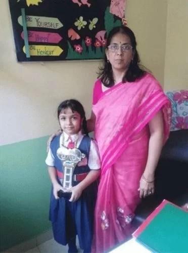 Aditi Jaltare with her school teacher