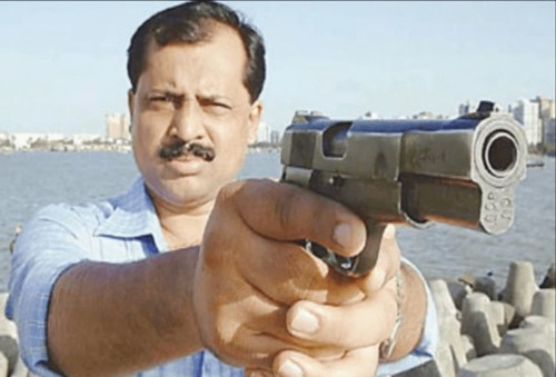 Old picture of Sachin Vaze with a gun