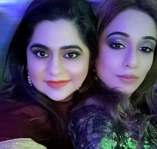 Shlokka Pandit with her sister