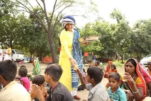 Bharti Shri Ji distributing food among needy people