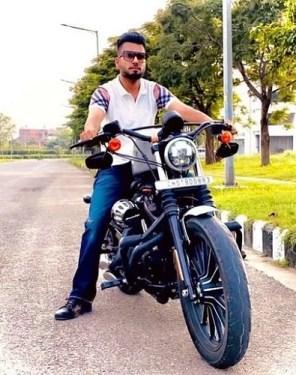 DJ Flow posing on his motorcycle