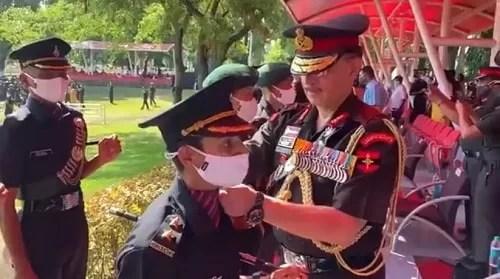 Lt Gen Y K Joshi putting the rank badges on Nitika Kaul's shoulder