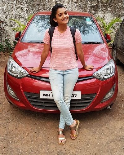 Hruta Durgule with her car
