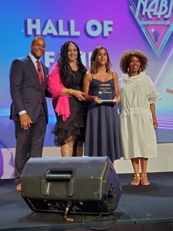 Alexi McCammond receiving an award from the National Association of Black Journalists in 2019