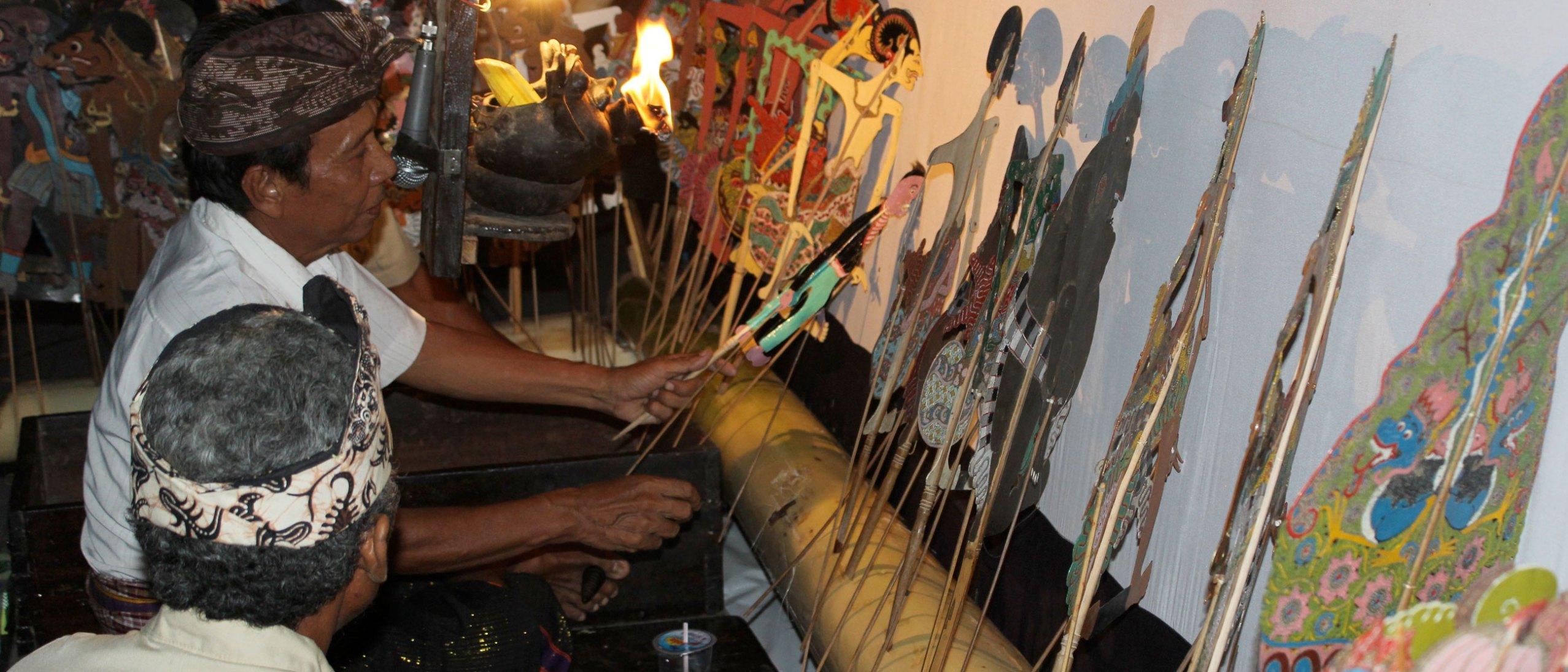 Man examining puppet