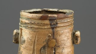 Detail of the opening of a Momoyama period vase, showing a variety of glazes, cracks, and other imperfections