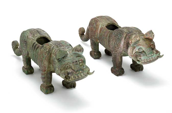 Chinese bronze tiger fittings from 900 BCE; F1935.21 and F1935.22