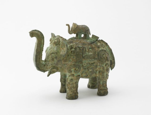 Lidded ritual ewer (huo) in the form of an elephant with masks and dragons; Middle Yangzi Valley, China, Shang dynasty, Late Anyang period, ca. first half 11th century BCE; bronze; Purchase, F1936.6a–b
