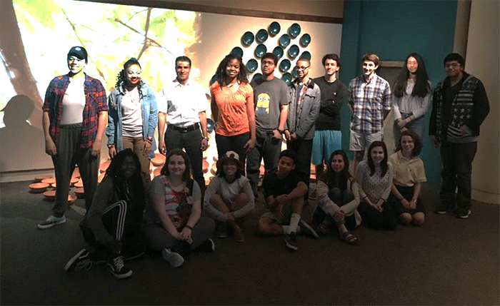 Turquoise Mountain artisan Abdul Matin Malekzadah (back row, third from left) with members of the ArtLab+ and Teen Council, which filmed the video in the exhibition.