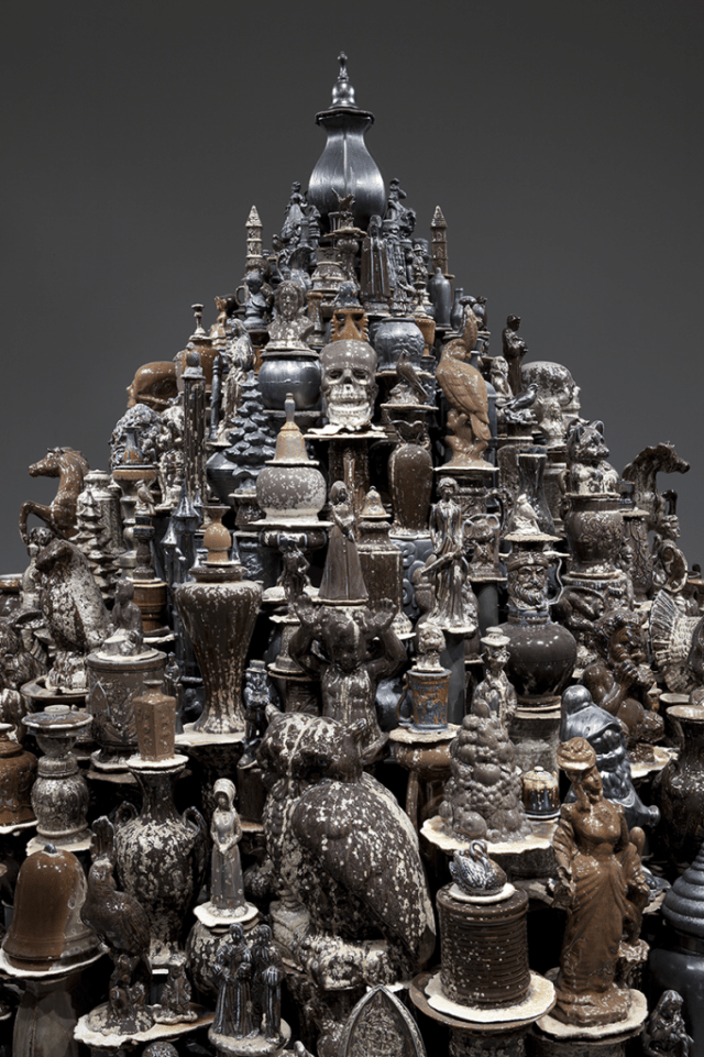A Theory of Everything: Dark Stupa; Walter McConnell (b. 1956) 2014 and 2004–16; cast porcelain from salvaged hobby industrial molds, zinc crystalline glaze, sand, and plywood shelving; courtesy the artist and Cross MacKenzie Gallery, Washington, DC