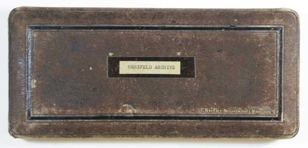 "Brown box lid with label: ""Herzfeld Archives"""