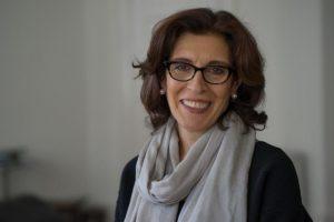 Headshot of curator Massumeh Farhad smiling
