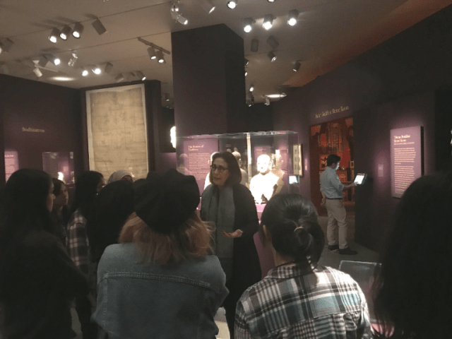 """Curator Debra Diamond meets with members of the Teen Council in """"Encountering the Buddha."""""""