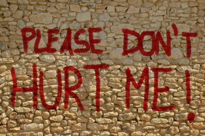 please don't hurt me paint on the wall