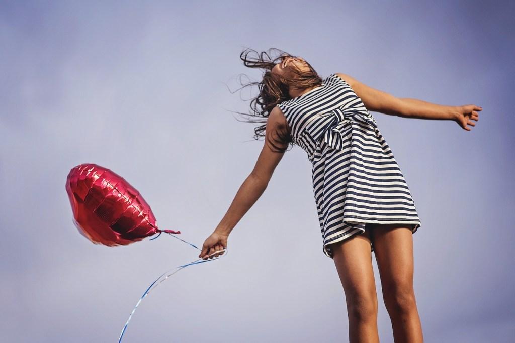 joyful woman with balloon